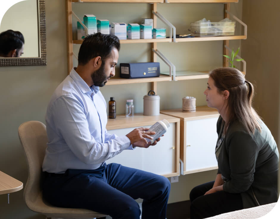 Chiropractor talking to patient about medication
