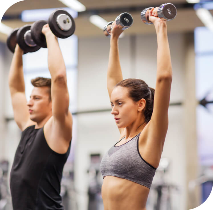 Man and woman lifting weights in a gym